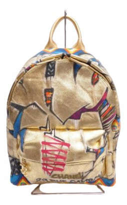 Chanel Gold Cloth Backpacks