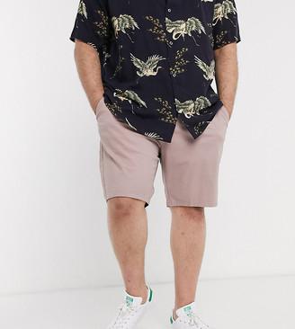 ASOS DESIGN Plus slim chino shorts in warm pink