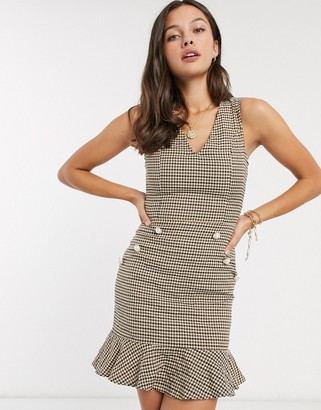 Parisian tweed dress with fluted hem with pearl effect buttons