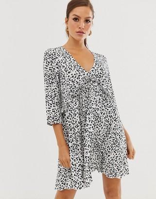 Asos DESIGN pleated smock mini dress in mono leopard print