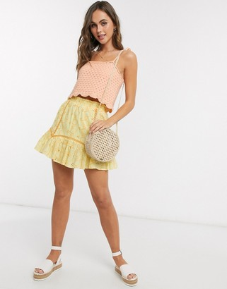 Asos DESIGN lemon broderie mini skirt with lace insert in yellow