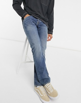 Edwin ED55 regular tapered fit jeans in washed blue denim