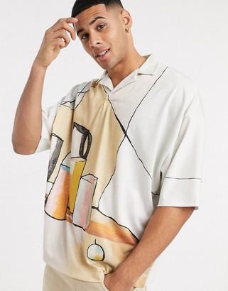 ASOS DESIGN oversized pullover revere collar polo in all over art print