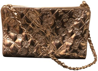 Chanel Mademoiselle Gold Leather Clutch bags