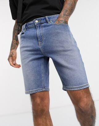 ASOS DESIGN skinny denim shorts in mid wash blue