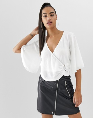 Asos Design DESIGN angel sleeve textured jersey wrap top with ring detail-White