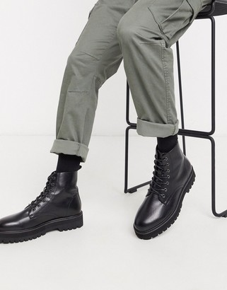 Asos DESIGN lace up boot in black faux leather with raised chunky sole