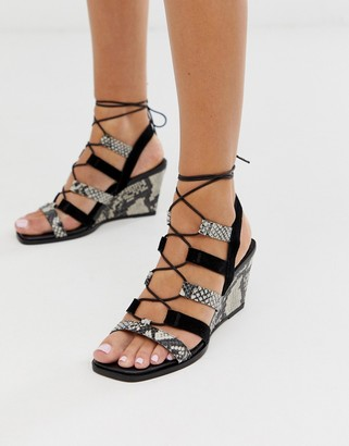 Asos Design DESIGN Hansel suede mix mid heeled wedges in snake and black-Multi