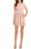 B. Darlin Laser Cut Scalloped Hem Skater Dress