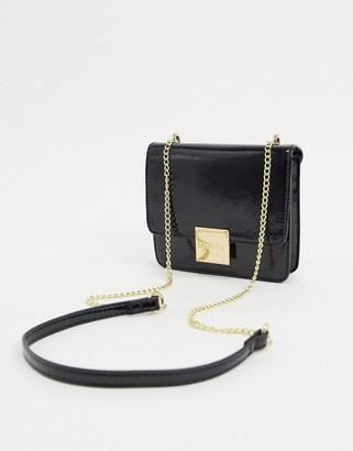 Carvela patent mini cross body bag in black