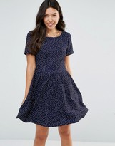 Yumi Short Sleeve Tie Back Dress In Polka Dot