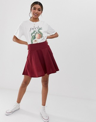 ASOS DESIGN mini skater skirt with drop pockets in texture