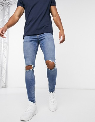 ASOS DESIGN Cone Mill Denim spray on jeans with power stretch in vintage mid wash blue with knee rips