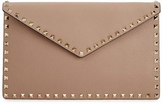 Valentino Rockstud blush leather clutch