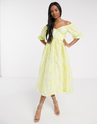 ASOS DESIGN puff sleeve midi dress in floral organza with lace up back in yellow