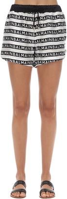 Balmain All Over Logo Silk Satin Shorts