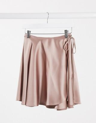 Asos DESIGN satin wrap mini skirt in blush pink