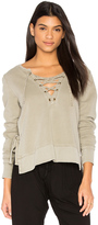 Pam & Gela Side Slit Lace Up Sweatshirt