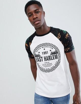 Asos Design DESIGN t-shirt with geo-tribal raglan sleeve and city print-White