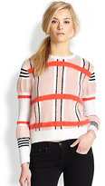 taylor swift  Who made Taylor Swifts pink stripe sweater and red handbag?