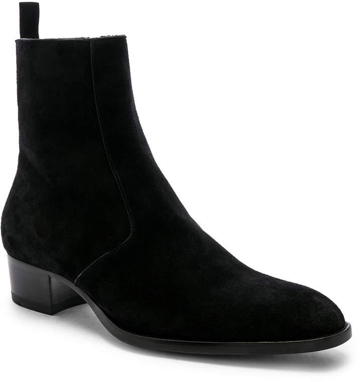 Saint Laurent Wyatt Zipper Boots in Black | FWRD