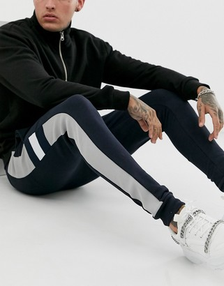Asos Design DESIGN jersey skinny joggers with knitted side panel in navy