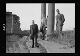 Historic Photos 1938 Photo Jebel el-Druze & Hauran. Basra Eski Sham. Two pillars of colonnade with group. Torrence, Grossman, & Terrill Location: Bu?rá Al, Sh?m, Syria
