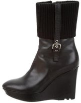 Louis Vuitton Monogram-Accented Wedge Ankle Boots