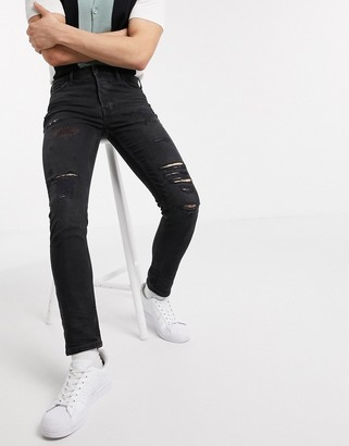Topman organic skinny jeans with rips in black