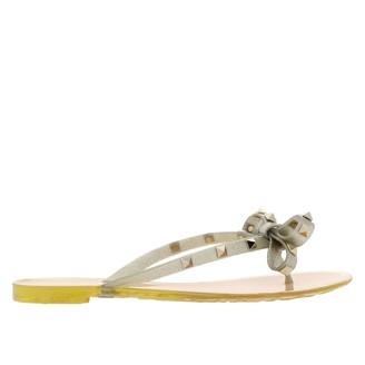 Valentino Garavani Rockstud Flip Flop Sandal With Bow