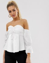 Koco & K milkmaid lace up front top with bell sleeve in white