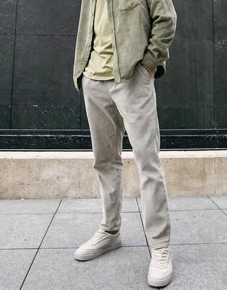 ASOS DESIGN elasticated waist cord slim pants in washed khaki