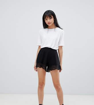 Asos DESIGN Petite culotte shorts with lace hem-Black