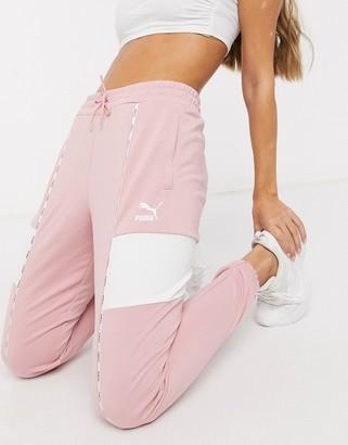 Puma XTG track pants in bridal rose