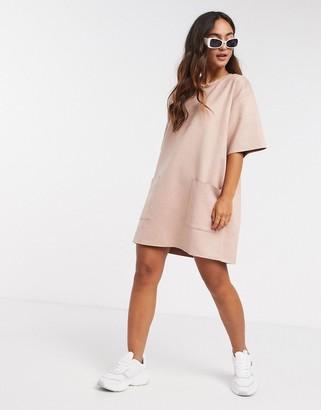 ASOS DESIGN oversize suedette t-shirt dress with pocket detail in pink