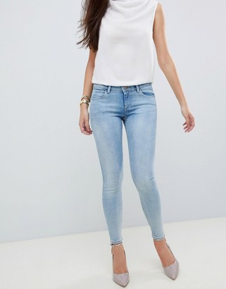 Asos DESIGN Whitby low waist skinny jeans in light stonewash blue
