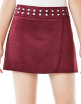 BCBGMAXAZRIA Dorthy Grommeted Faux-Suede Mini Skirt