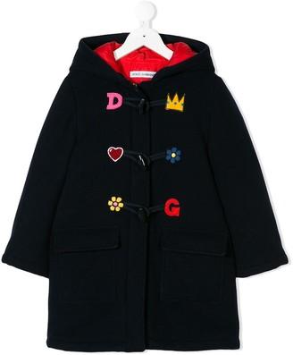 Dolce & Gabbana patch appliqués coat