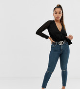 Asos DESIGN Petite Ridley high waisted skinny jeans in dark wash blue with ripped knee detail