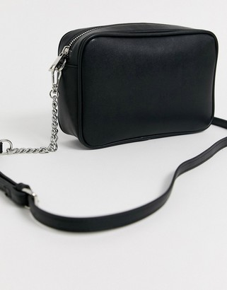 Truffle Collection black cross body bag with tassel