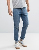 Asos Slim Low Impact Jeans In Mid Blue