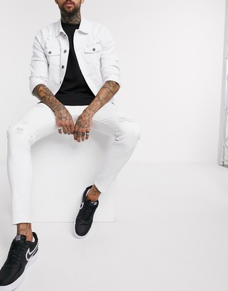 Liquor N Poker skinny fit jeans with abrasions in white