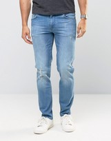 Asos Stretch Slim Jeans With Abrasions In Light Wash Blue