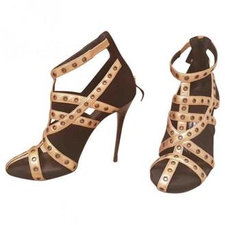 Alexander McQueen Gold Suede Sandals
