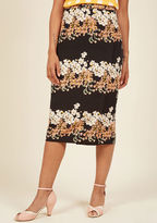 DB17050023 From weekend brunches to weekday syncs, this black pencil skirt presents yourself at every gathering with the utmost poise! A full side zipper and rows of white pink, and green flowers give this midi-length bottom class and character - both of which are e