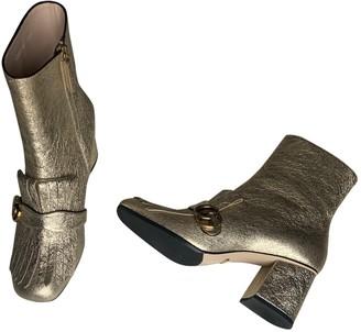 Gucci Gold Faux fur Boots