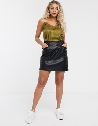 Only leather look skirt with pocket detail in black
