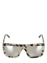 gwen stefani  Who made  Gwen Stefanis animal print sunglasses and black sandals?