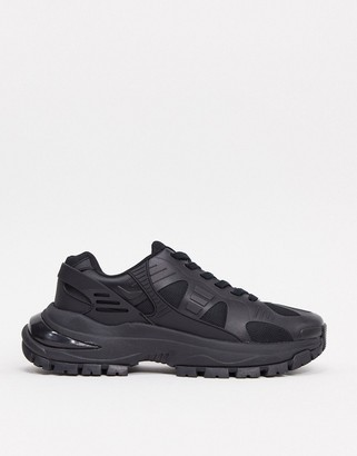 ASOS DESIGN trainers in black with chunky sole and rubber panels