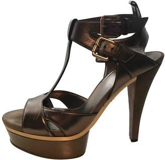 Gucci Metallic Leather Sandals